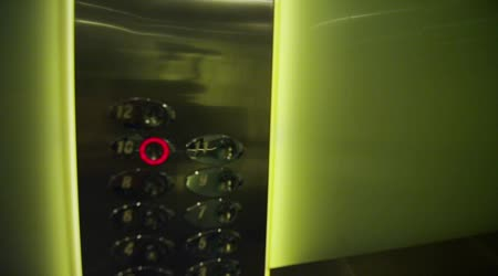Fingers pressing the buttons in an elevator
