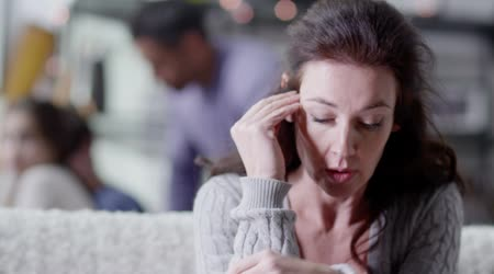 A woman is upset and stressed about her life