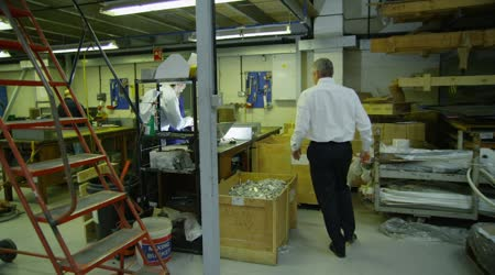 Friendly informal business meeting in a factory or warehouse