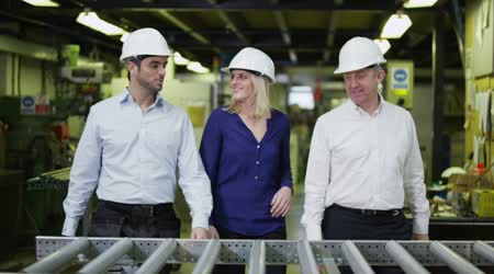 Portrait of attractive warehouse management staff of mixed ages