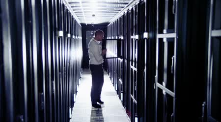 Male IT engineer is working in data center