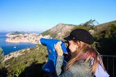 Tourist using telescope, Dubrovnik old town, Croatia