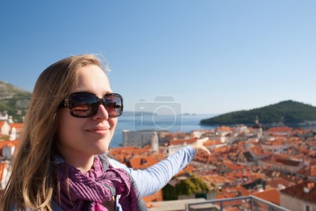 Tourist woman looking at Dubrovnik from the city walls