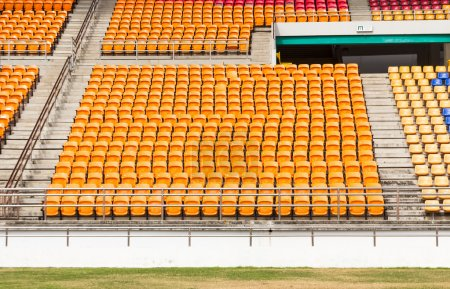 Rows of empty plastic stadium seats