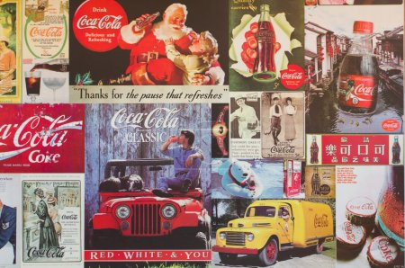 Old poster Coca Cola on wall
