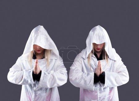 Two transvestites in white cloaks