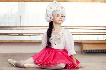 Photo for Image of pretty young Russian ballerina posing in ballet class - Royalty Free Image