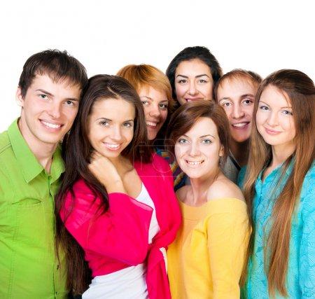 Photo pour Groupe de jeune heureux de qualité pour agir ensemble au blanc - image libre de droit
