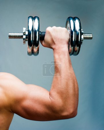 Photo for Arm attractive athletic man with dumbbells - Royalty Free Image