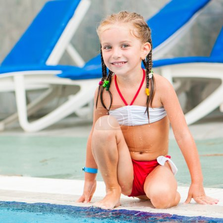 Photo for Pretty little girl near swimming pool - Royalty Free Image