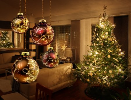 Photo for Christmas tree lights reflecting from glass balls and mirror - Royalty Free Image