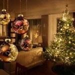 Christmas tree lights reflecting from glass balls ...