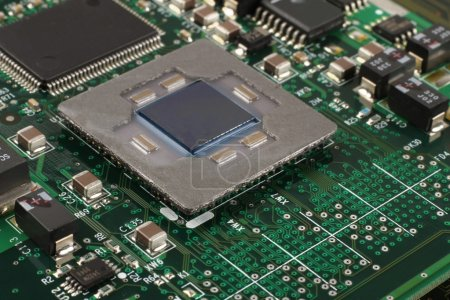 Photo for Computer microprocessor on integrated circuit motherboard closeup - Royalty Free Image