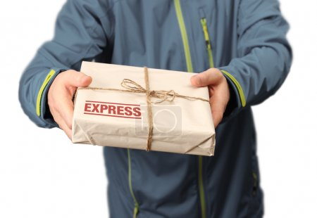 Photo for Male courier service worker or postman holding express delivery package - Royalty Free Image