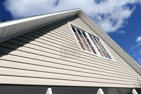 House exterior, roof close-up. Low angle view.
