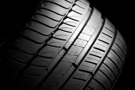 Photo for Modern high-performance sport summer tire on a black background. Low key scene. - Royalty Free Image
