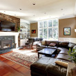 Luxury living room with stobe fireplace and leathe...