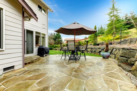 Home patio area overlooking beautiful landscaping