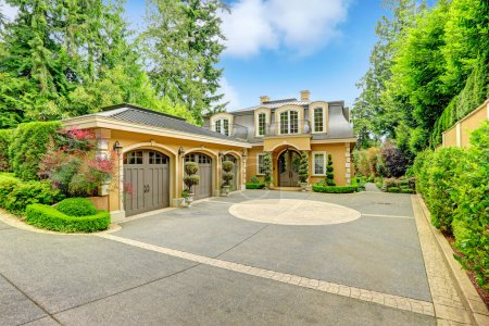 Photo for Luxury house with beautiful curb appeal. View of three car garage and driveway - Royalty Free Image