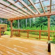 Spacious wooden deck with benches overlooking natu...