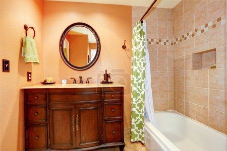 Carved wood bathroom vanity cabinet with mirror