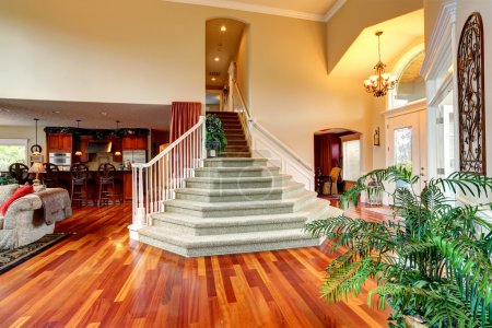 Photo for Luxury house interior with high ceiling. Spacious foyer with beautiful staircase - Royalty Free Image