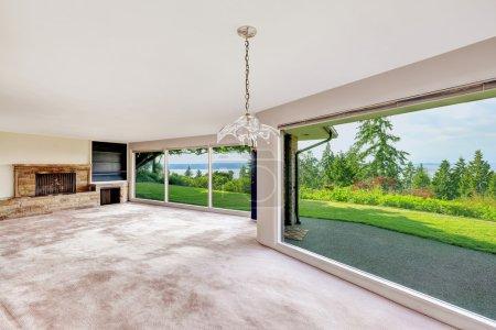 Spacious empty living room with panorama windows. ...