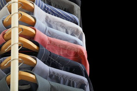 Photo for Variety of shirts on hangers - Royalty Free Image