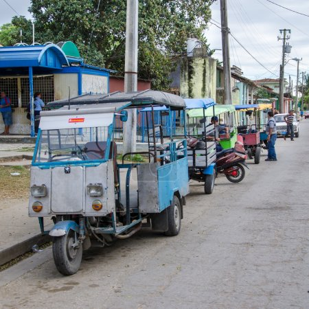 Line of Taxi Motorbikes to Take Work