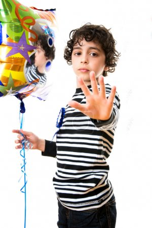 Child Refusing to be photographed. Serious Expression over a white background.