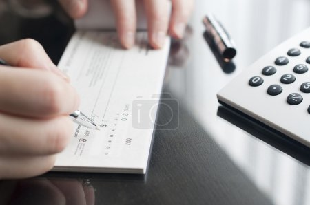 Photo for Business woman prepare writing a check - Royalty Free Image