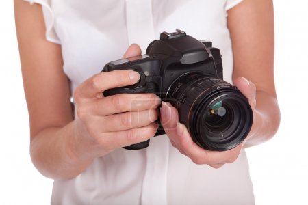 Photo for Digital camera in female hands on a white background - Royalty Free Image