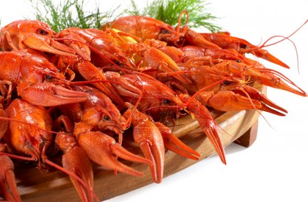 boiled crawfish on the wooden plate