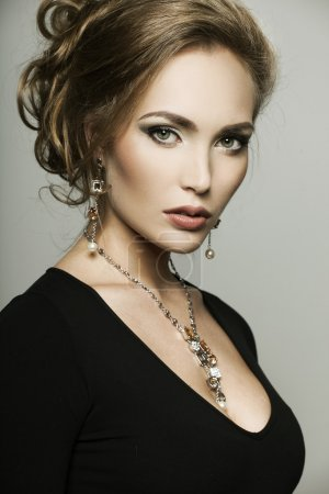portrait of a beautiful woman with perfect makeup wearing jewelry