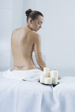 Beautiful woman in a medical beauty center on massage therapy