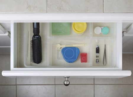 Photo for Open bathroom drawer with personal hygiene accessories displayed - Royalty Free Image