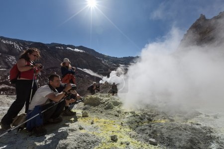 Tourists In crater of active volcano of Kamchatka