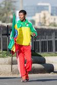 Haile Gebrselassie holding the Ethiopian Flag