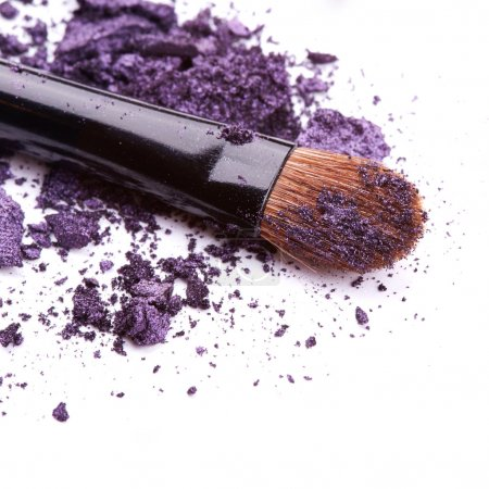 Purple eye shadow with brush