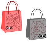 Borse per la spesa con un ragno e web su sfondo bianco