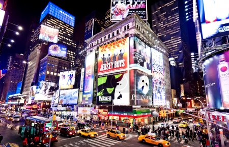 Photo for NEW-YORK - JANUARY 6: Illuminated facades of Broadway theaters on January 6, 2011 in Times Square, NYC - Royalty Free Image