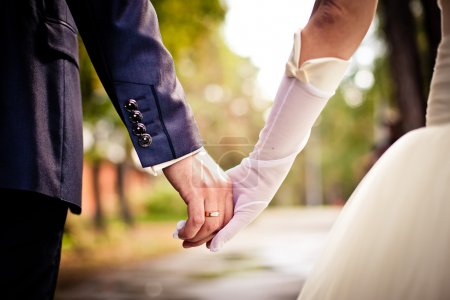 Photo for Closeup of bride and groom holding hands - Royalty Free Image