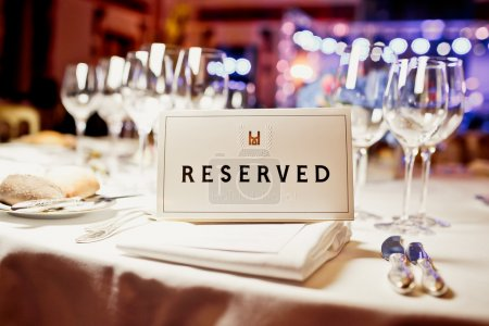 Photo for Reserved sign on a table in restaurant - Royalty Free Image