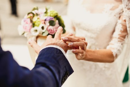 Photo for Close up of holding hands with wedding rings - Royalty Free Image