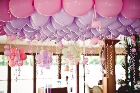 Photo for Many purple and pink balloons under the ceiling on the wedding party - Royalty Free Image