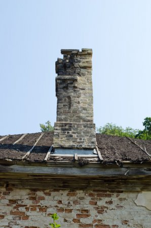 Ancient collapsing building wall roof and chimney
