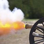 A close up shot of a Civil War cannon fireing at a...