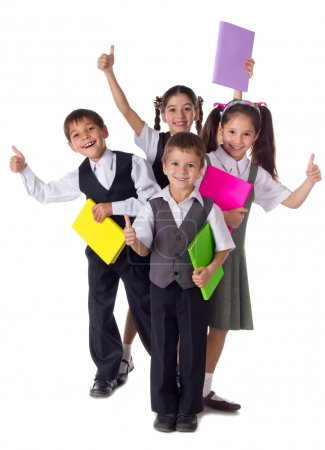 Smiling kids standing with books