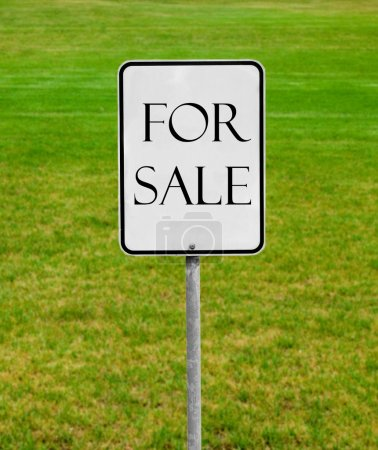 Photo for For sale sign on the green lawn - Royalty Free Image