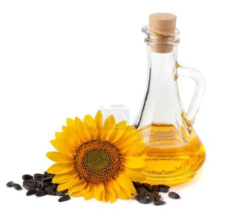 Photo pour Huile de tournesol avec fleur et graines. Sur fond blanc - image libre de droit